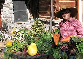 Lyn Kneese with her giant homegrown carrots
